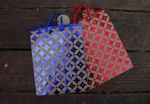 small presents bags with ancient geometric patterns
