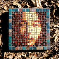 Green and Sepia Asian face mosaic.