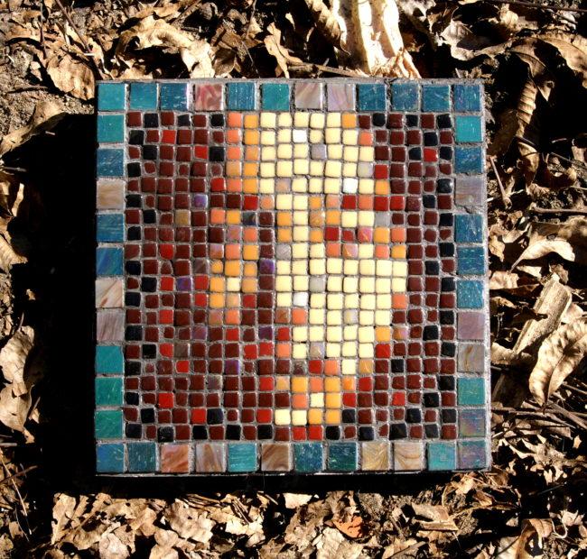 Green and Sepia Asian face mosaic.