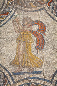 Tambourine player mosaic, House of Dyonisos, Volubilis, Morocco