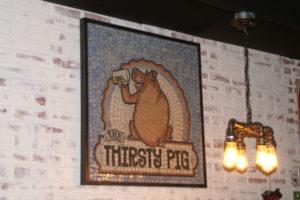 The THirsty Pig mosaic.