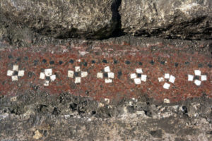 Croisettes made of white and black tesserae adorning an antique floor opus signinum discovered in Uzès (