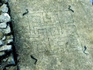 Opus signinum floor, Svastika & Dolphins, Uzes, France