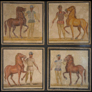Mosaic depicting charioteers and horses such as the ones participating in the races that started the Nika riots.