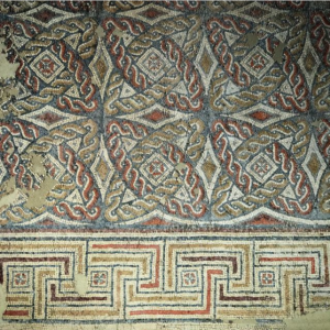 Plassac's mosaic style in evolving between the earlier and later styles of the Aquitaine school of mosaics.
