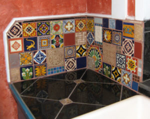 mexican tiles refelct on dark granite tiles to illustrate the Redfin blog